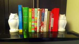 Cookbooks on top of the fridge.